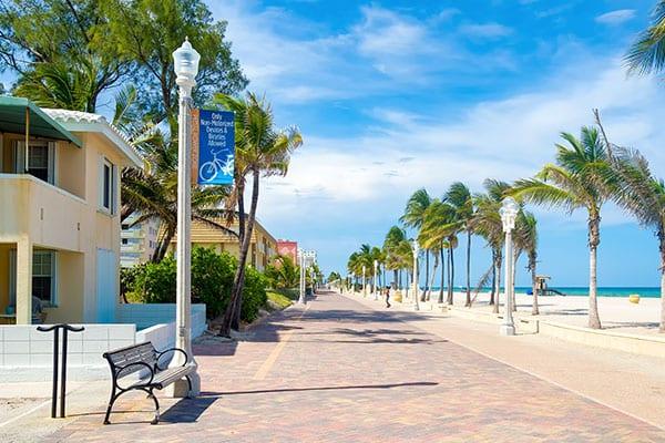 beachwalk-resort-in-hallandale-beach-florida-two-drinks-on-side-of-pool