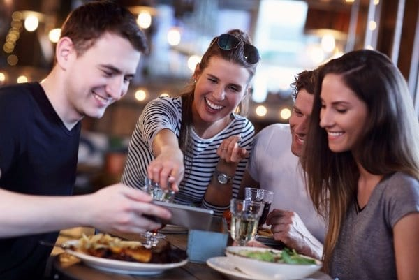 stay-and-play-with-miami-group-of-people-eating-out-at-restaurant