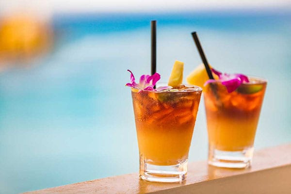 beachwalk-resort-in-hallandale-beach-florida-two-drinks-on-side-of-pool